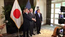Japan's Defence Minister Takeshi Iwaya (L), US Defence Secretary Jim Mattis (C), and South Korea's D