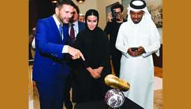 Shaikha al-Sulaiti explains about her exhibit 'Msheireb Light' to Pasquale Salzano and Ali al-Kuwari