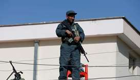An Afghan policeman keeps watch at a polling station in Kabul, Afghanistan