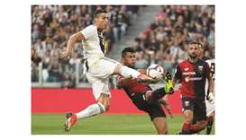 Ronaldo nets landmark goal but Juve's perfect run broken by Genoa