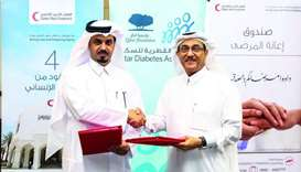 Executive Director of Qatar Diabetes Association Dr Abdullah Omar al-Hamaq and Executive Director of
