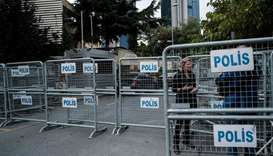 A journalist stands next to police barriers, in front of the Saudi consulate in Istanbul.