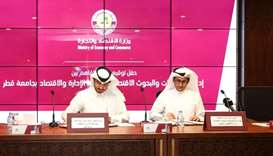 The MEC and QU officials sign the MoU