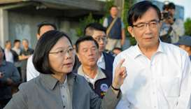 Taiwan's President Tsai Ing-wen (L) gestures during a briefing of a search and rescue team at Xinma