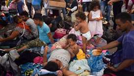 Honduran migrants taking part in a caravan heading to the US, rest at the main square in Tapachula,
