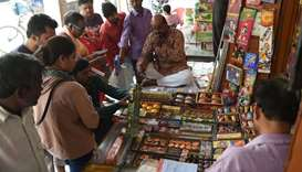 Indian customers visit a firecracker shop in New Delhi