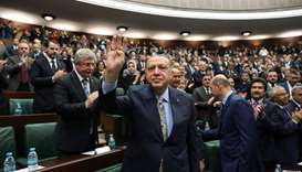 Turkish President Tayyip Erdogan greets members of parliament from his ruling AK Party (AKP) during