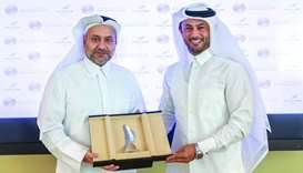 al-Jaida and al-Suwaidi after signing the pact to establish Qatar Sports Business District.