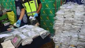 Police display a portion of the six tonnes of cocaine, money and other material seized at an industr