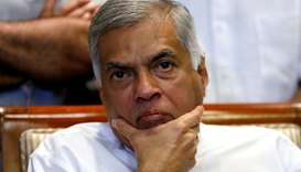 Sri Lanka's ousted Prime Minister Ranil Wickremesinghe reacts during a news conference in Colombo, S