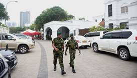 Sri Lankan soldiers walk outside the prime minister's official residence in Colombo