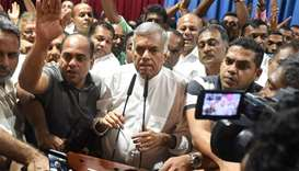 Sri Lanka's ousted prime minister Ranil Wickremesinghe (C) speaks to his supporters at the Prime Min
