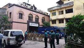 Bangladeshi police stand guard in front of a jail-turned-court where a verdict was being delivered o