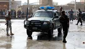 Afghan policemen keep watch at the site of a suicide attack in Kabul
