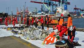 Rescue team members arrange Lion Air flight JT610 wreckage at Tanjung Priok port in Jakarta