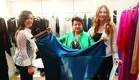 (From right) Valeria Mangani with Anna Marchetti and daughter showing one of their unique designs at
