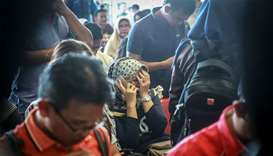 Family members of the crashed Indonesian Lion Air JT-610 react at Pangkal Pinang airport