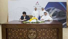 HE Jassim Seif Ahmed al-Sulaiti with other dignitaries at the signing of the agreement for 35 additi