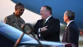 US Secretary of State Mike Pompeo (C) talks with US ambassador to South Korea Harry Harris (R) and U