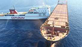 A roll-on/roll-off ferry (L) and a container ship after they collided off the northwest coast of Cap
