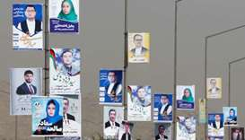 Election posters of parliamentary candidates during the first day of election campaign in Kabul