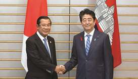 Japanese Prime Minister Shinzo Abe, right, and Cambodia's Prime Minister Hun Sen