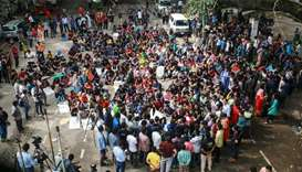 Students of Bangladesh University of Engineering and Technology (BUET) block a road and take part in
