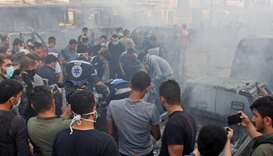 People gather at the site of an explosion in the northeastern Syrian Kurdish city of Qamishli