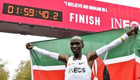 Kenya's Eliud Kipchoge celebrates in the finish area of a special course after busting the mythical