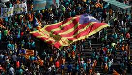 "People hold a giant ""Estelada"" (Catalan separatist flag) at a rally during Catalonia's national day"