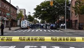 A crime scene is established in front of the Triple A Aces social club on Utica Avenue on October 12