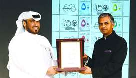 Qatar Post COO Hamad Mohamed al-Fahida and Indian ambassador P Kumaran releasing the postal stamp.