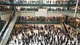 People attend a flash mob rally inside a shopping mall in the Sha Tin district in Hong Kong