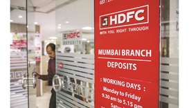 A customer exits a branch of HDFC Bank in Mumbai. Investors keep piling into HDFC Bank's stock, conv