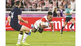 Japan's Kotaro Matsushima (right) scores a try during the Japan 2019 Rugby World Cup Pool A match ag