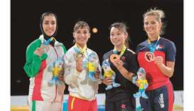 Gold medallist Damian Quintero of Spain (2nd from left), runner-up Yi Ta Wang (1st left) and joint b
