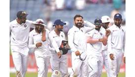 India captain Virat Kohli (fourth from left) celebrates with teammates after winning the second Test