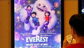 "A boy looks at a poster for the animated movie ""Everest Nguoi Tuyet Be Nho"", also known as ""Abominab"