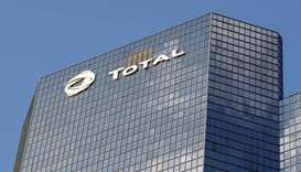 A logo of French oil company Total is seen at an office building in La Defense business district in
