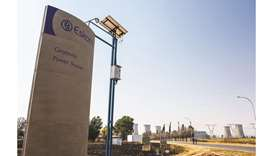 A sign stands outside the entrance road to Eskom's Grootvlei coal-fired power station in Mpumalanga,