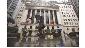 Pedestrians walk past the New York Stock Exchange building (file). The S&P 500 Index rose 1.1% on Fr