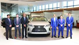 Officials flank the new 2020 Lexus RX.