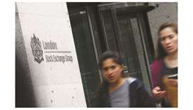 Pedestrians walk past the London Stock Exchange. The FTSE 100 was down 0.5% to 7,213.45 points yeste