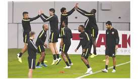 Qatari players train for the match against Oman yesterday. Picture on right shows Qatar Football Ass