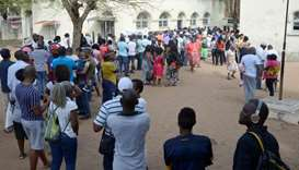 People queue to cast their votes during the presidential, legislative and provincial elections in Ma