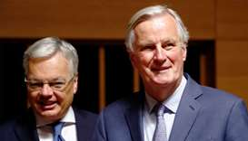 EU's Chief Brexit Negotiator Michel Barnier walks with European Justice Commissioner-designate Didie