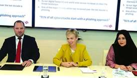 Leonie Ruth Lethbridge (centre) speaks while chief information security officer Benjamin Beaston (le