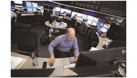 Traders monitor financial data inside the Frankfurt Stock Exchange. The DAX 30 closed up 1.2% to 12,