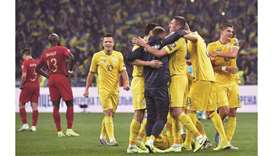 Ukraine's players celebrate after the Euro 2020 qualification win over Portugal at the NSK Olimpiysk