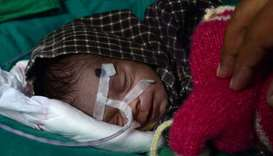 A newborn baby girl rests at a hospital in Bareilly in northern India's Uttar Pradesh state where sh